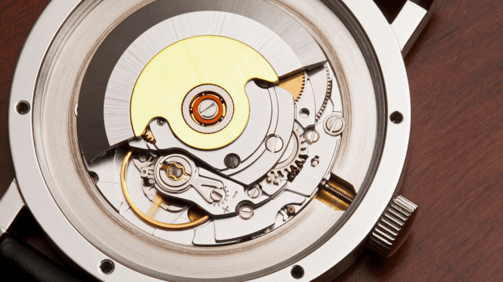 Photo of the inside of a automatic mechanical watch movement.