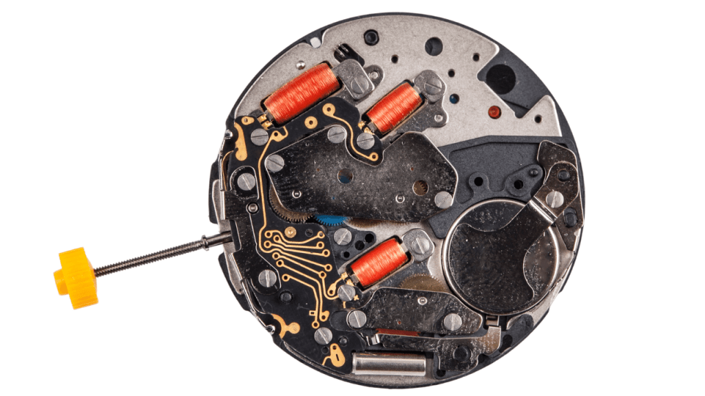 Photo of the inside of a quartz watch movement.
