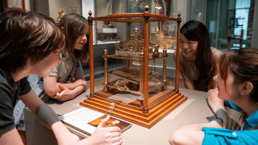 People gathered around the Congreve Clock at the British Museum in London