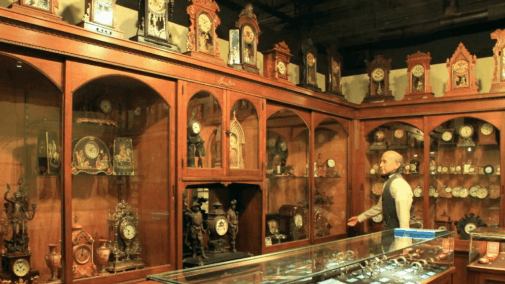 A display of clocks and watches in the style of an old fashioned shop inside the National Watch & Clock Museum