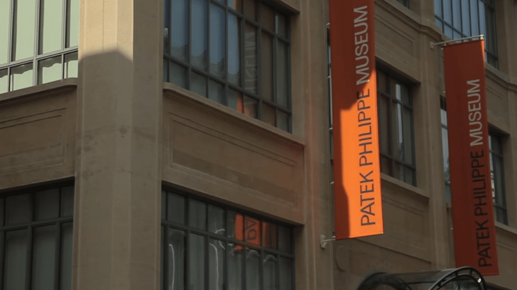 Patek Phillipe Museum, two orange flags on the outside of the museum.